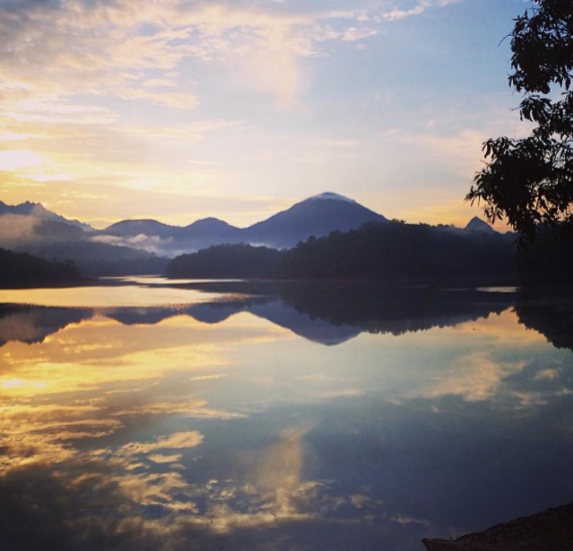 Kerala tourism - a landscape image of the neyarr dam region at sunrise
