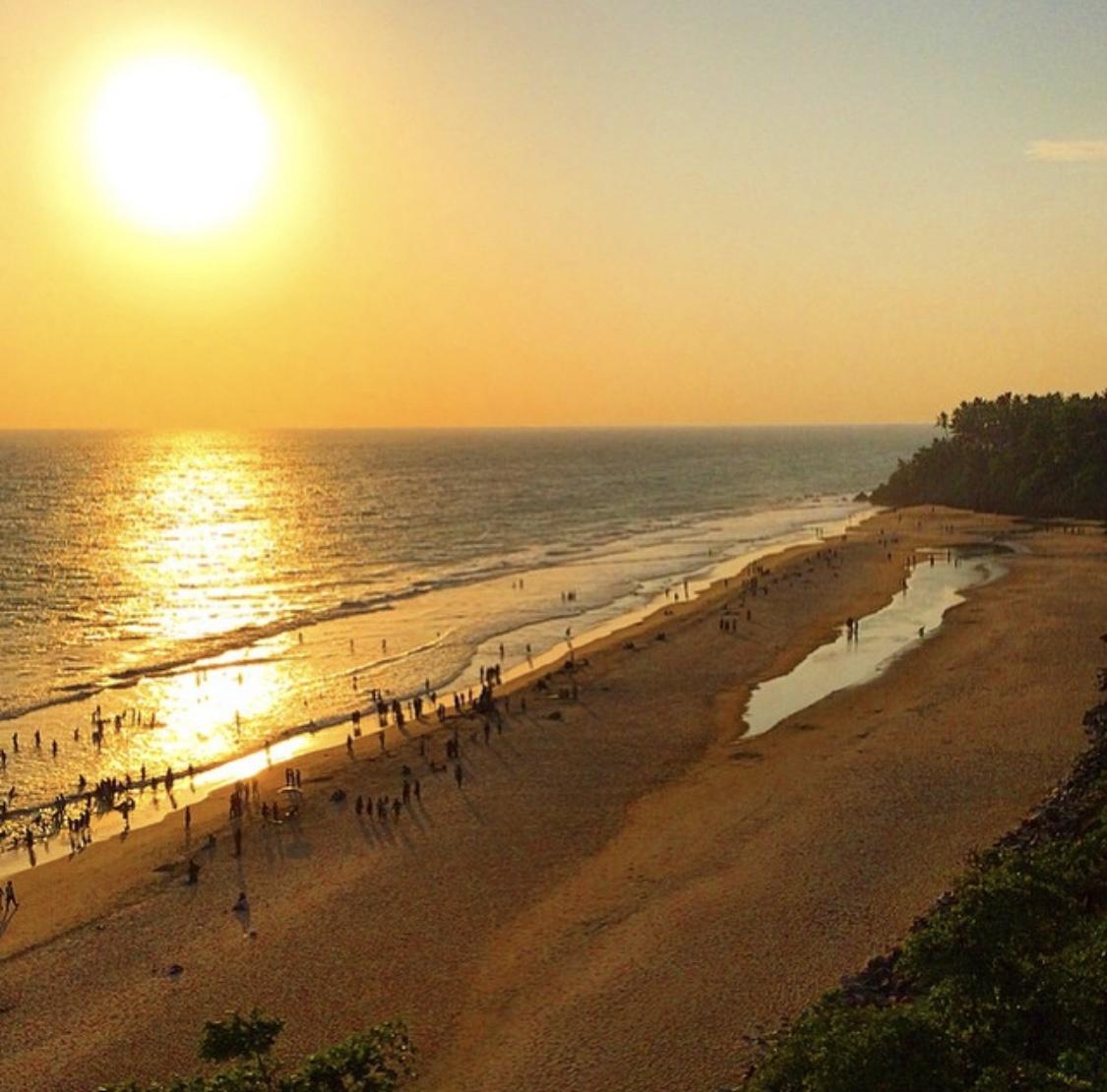 Kerala tourism - a landscape image of Varkala beach at sunset along Kerala's western coastline